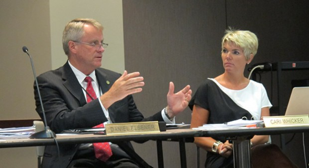 State Board of Education member Dan Elsener speaks during a meeting as fellow board member Cari Whicker looks on.