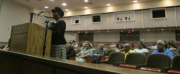Parents speak during a public hearing with state and district officials on intervention plans for Indianapolis' John Marshall High School in June 2012. Four out of five students in the school at the time were black.
