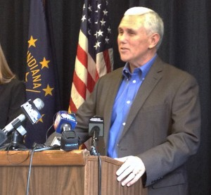 Gov. Mike Pence speaks to reporters.