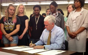 Gov. Mike Pence, during an event at Warren Central High School in Indianapolis,  signs an executive order creating the Center for Education & Career Innovation.