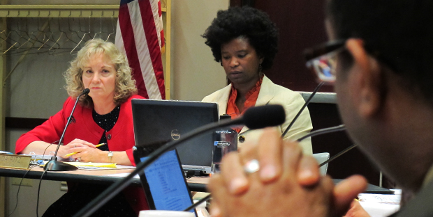 State superintendent Glenda Ritz looks on as State Board of Education member Tony Walker speaks during a board meeting in September.