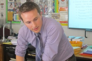 Teacher Ryan Davis answers a question in his geometry class at Central High School in Louisville, Ky.