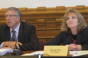 Southwest Allen County Superintendent Steve Yager, left, and State Superintendent Glenda Ritz listen to a presentation during the final A-F panel meeting.