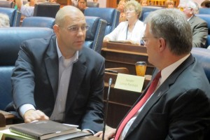 Sen. Scott Schneider, R-Indianapolis, talks with Sen. Tim Skinner, D-Terre Haute, before the third Common Core panel.