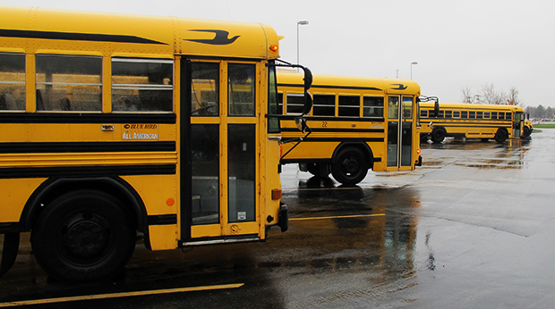 Buses lined up waiting for students at a school in Hancock County, Indiana.