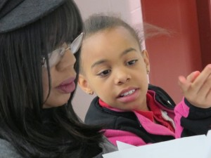 Fourth grader Jalea talks with her tutor, Helen Dalton, at an after-school tutoring program put on by a local food bank in East Chicago.
