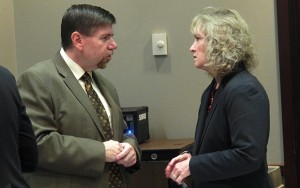 State superintendent Glenda Ritz speaks to State Board of Education member Brad Oliver after returning from a recess during which her staff and representatives of the Center for Education and Career Innovation hashed out a motion for the panel to approve a conceptual framework for a new A-F grading system.