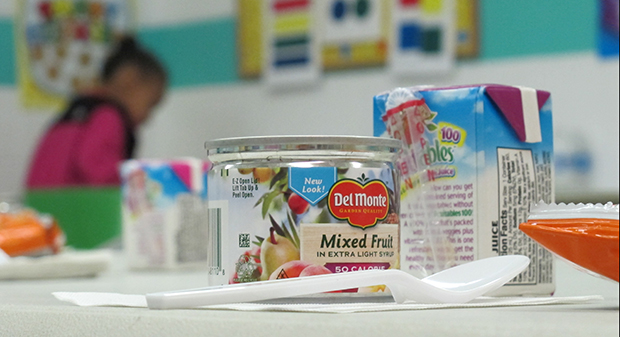 An after-school snack sits on a table waiting for students an East Chicago community center classroom. It's part of the