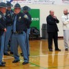 More than 30 law enforcement personnel provided security at the Northeast School Corporation Board of Trustees meeting. Attendees had to pass through a metal detector before entering the North Central High School gym.