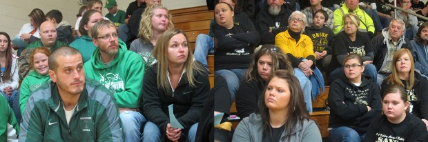 Advocates for closing Union Junior-Senior High School and Dugger Elementary, left, sit on one side of the North Central High School gym during a Northeast School Corporation meeting. On the other side sit members of the Save Union High School group.