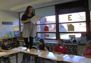 Glenwood Leadership Academy fourth grade teacher Amber Santana leads her students in multiplication drills while pacing across her their desktops. Santana is in her second year at the school.