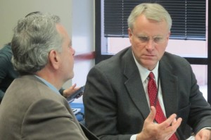 State Board of Education members David Freitas, left, talks to Dan Elsener during a strategic planning meeting Dec. 3.
