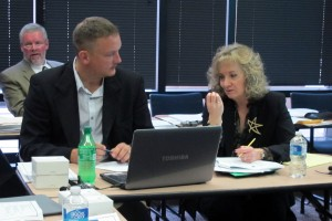 State superintendent Glenda Ritz, right, talks to State Board of Education member B.J. Watts during a strategic planning session on Dec. 3.