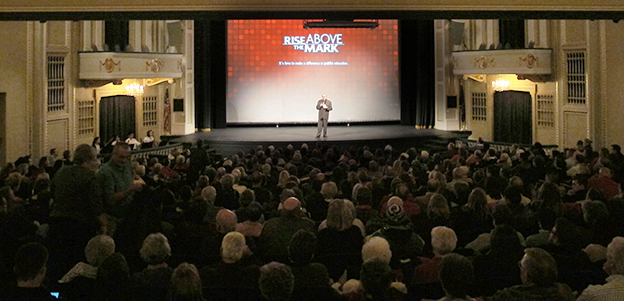 "More than 1,000 people pack downtown Lafayette's Long Center for the Performing Arts for the premiere of ""Rise Above The Mark."" Donations to the West Lafayette Schools Education Foundation funded the film's production and district officials were critical to crafting its message."