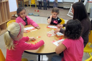 Students play a bingo game to help improve their counting skills at Busy Bees Academy, a public preschool in Columbus.