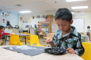 A student works on an art project at Busy Bees Academy, a public preschool in Columbus.