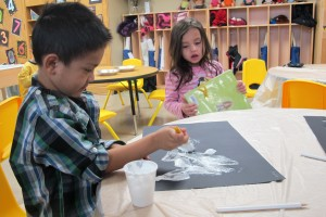 Students work on art projects at Busy Bees Academy, a public preschool in Columbus.