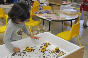 A student plays during an activity period at Busy Bees Academy, a public preschool in Columbus.