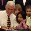 In this 2014 photo Gov. Mike Pence signs legislation creating a state-funded preschool pilot program. (Brandon Smith/Indiana Public Broadcasting)