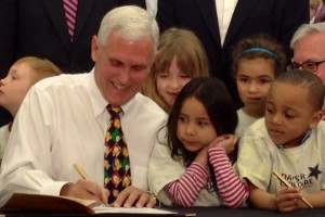 Gov. Mike Pence signs legislation creating a state-funded preschool pilot program.