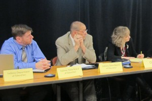 State Board members Brad Oliver, left, Troy Albert and Supt. Glenda Ritz listen to testimony on proposed standards during a public meeting in Sellersburg Feb. 24.