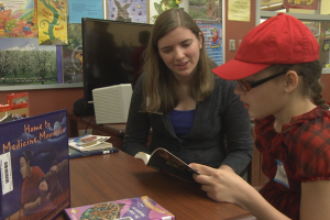 Elizabeth Huffman reads with her tutor at Fairview Elementary. The Bloomington school has brought in Indiana University students to tutor struggling readers.