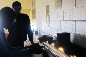 Providence Cristo Rey science teacher Andy Mundell helps a student measure sound waves.