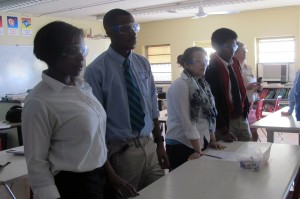 Students at Providence Cristo Rey High School don safety googles to watch an experiment.