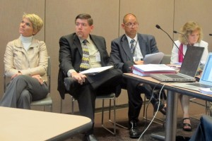Board members Cari Whicker, left, Brad Oliver, Troy Albert and state superintendent Glenda Ritz listen to a presentation before the standards vote.