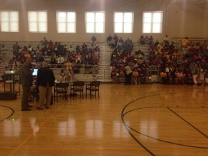 Community members pack the gym at Lincoln School for a public meeting about the school's failing accountability scores.