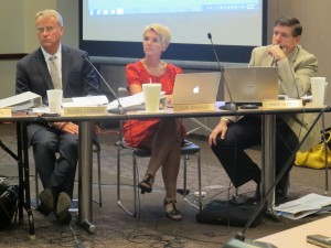 State Board of Education members Dan Elsener (left), Cari Whicker and Brad Oliver listen to updates on the state's settlement with CTB/McGraw-Hill.