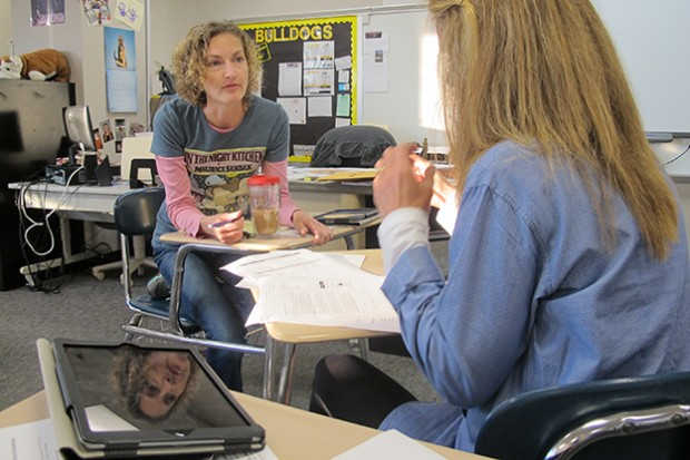 Batchelor Middle School Media Specialist Jaime Burkhart helps social studies teacher Becky Boyle plan a lesson for her students on the American Revolution.
