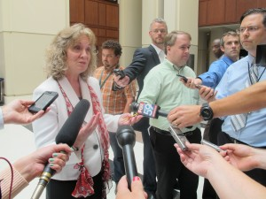 State Superintendent Glenda Ritz speaks to reporters outside the State Board of Education meeting in July, when she engaged with board members about her duties as board chair.