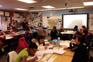 Steve Auslander directs a class activity for his fifth grade class at Allisonville Elementary using his SMARTboard technology.
