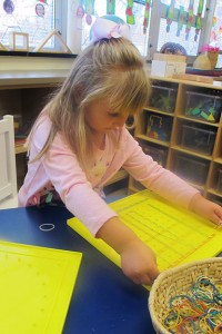 A preschool student in Columbus works in her classroom. (Photo Credit: Rachel Morello/StateImpact Indiana)