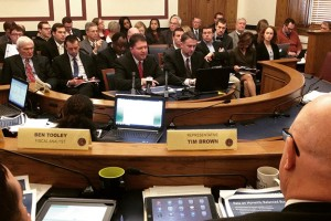 OMB Director Chris Atkins (center) and Budget Director Brian Bailey presenting the governor's budget Thursday to the State Budget Committee. (Photo Credit: Brandon Smith/IPBS)