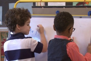 Four-year-old Datayvian Jackson (left) began attending pre-k just two weeks ago.