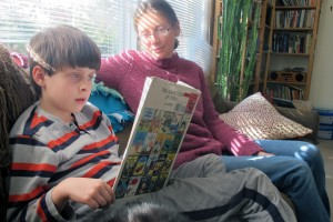 Jenny Robinson reads with her second grade son, Louis. Robinson says she is concerned about the amount of testing her children participate in, and wishes there was more time spent on creative learning.