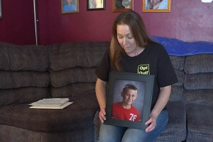 Bloomfield parent Resa Woodruff displays a picture of her son Caswell, 9. (Photo Credit: Barbara Harrington/WTIU News)