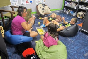 Summer preschool students in Jackson County work with their teacher in the classroom. (Photo Credit: Rachel Morello/StateImpact Indiana)