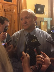 Sen. Luke Kenley, R-Noblesville, speaks with reporters after the release of the budget.