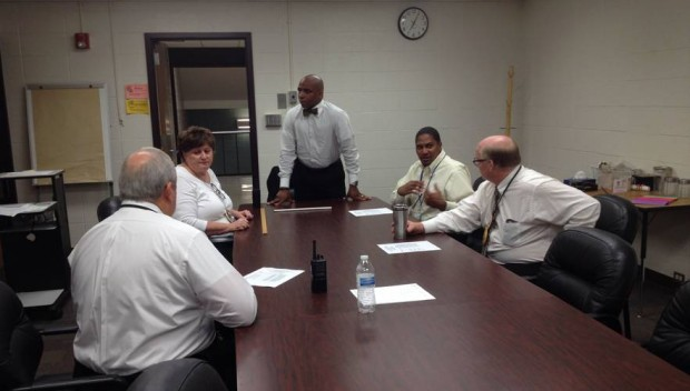 Arlington Principal Stan Law prepares his senior leadership team on Aug. 3, 2015 right before students are let in the building for the first time. (Photo Credit: Eric Weddle/WFYI Public Media)
