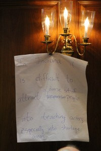 A worksheet from Thursday's Blue Ribbon Commission meeting hangs off a light in the House Chambers at the Indiana Statehouse. (Photo Credit: Rachel Morello/StateImpact Indiana)