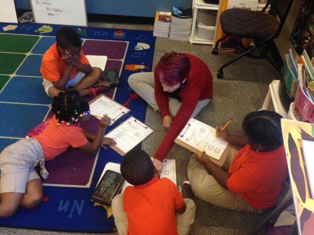 Melodi Miller, a Title I instructional assistant at the Paramount School of Excellence, helps lead her students during a math lesson. (Photo Credit: Rachel Morello/StateImpact Indiana)