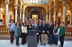 Sen. Tim Lanane (D-Anderson) with members of the Latino community at a press conference Monday outlining an education initiative that would allow in state tuition for undocumented students.