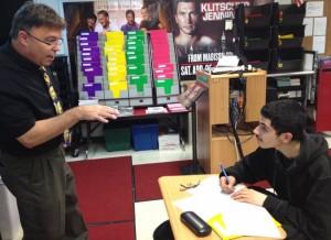 English teacher Kevin Sandorf explains some writing techniques to student Daniel Berverena during the Arlington High School's