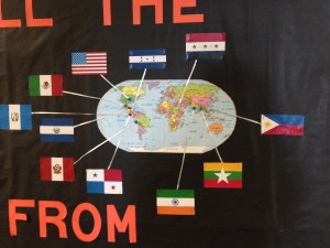 A map of all the home countries of students and their families graces the bulletin board outside Clinton Young Elementary School ELL teacher Sarah Laptiste's classroom. (Photo Credit: Rachel Morello/StateImpact Indiana)