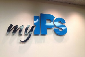 """My IPS"" sign hangs in the school board chambers. (Photo Credit: Eric Weddle/WFYI Public Media)"
