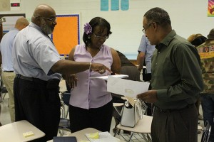 GCSC administrators work with education consultant Irving Jones over the summer. (Photo Credit: Rachel Morello/StateImpact Indiana)