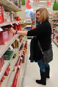 Third-grade teacher Abby Taylor checks out some sweet treats for this year's Christmas stockings. (Photo Credit: Rachel Morello/StateImpact Indiana)